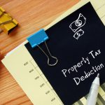 Financial concept meaning Property Tax Deduction with sign on the piece of paper.