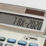 Tax word and 2020 number on calculator.